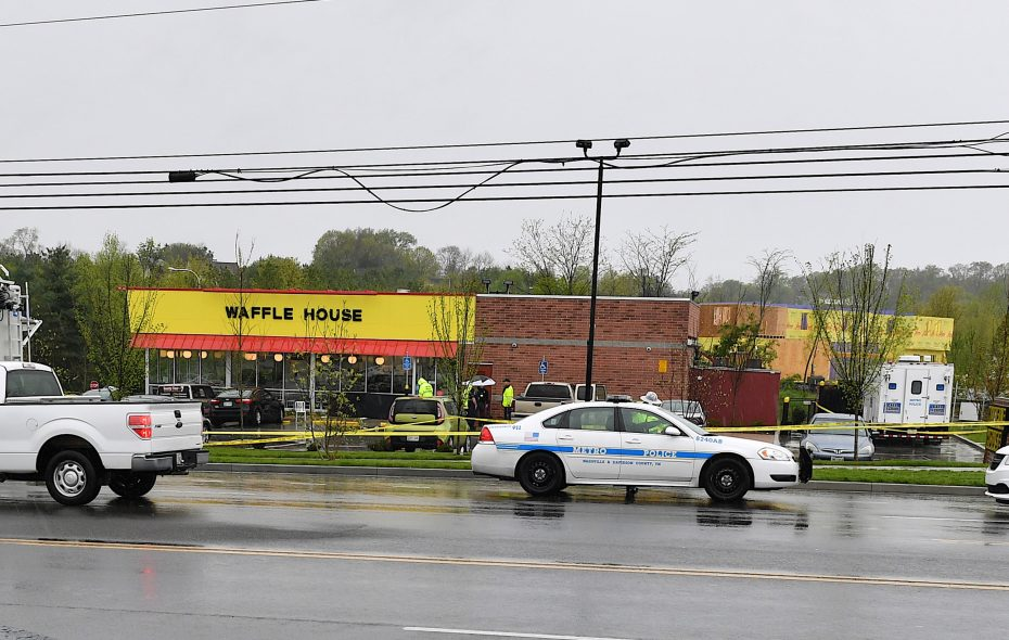 Law enforcement investigate the scene outside a Waffle House where four people were killed and two were wounded after a gunman opened fire with an assault weapon on April 22, 2018, in Nashville. (Getty Images)