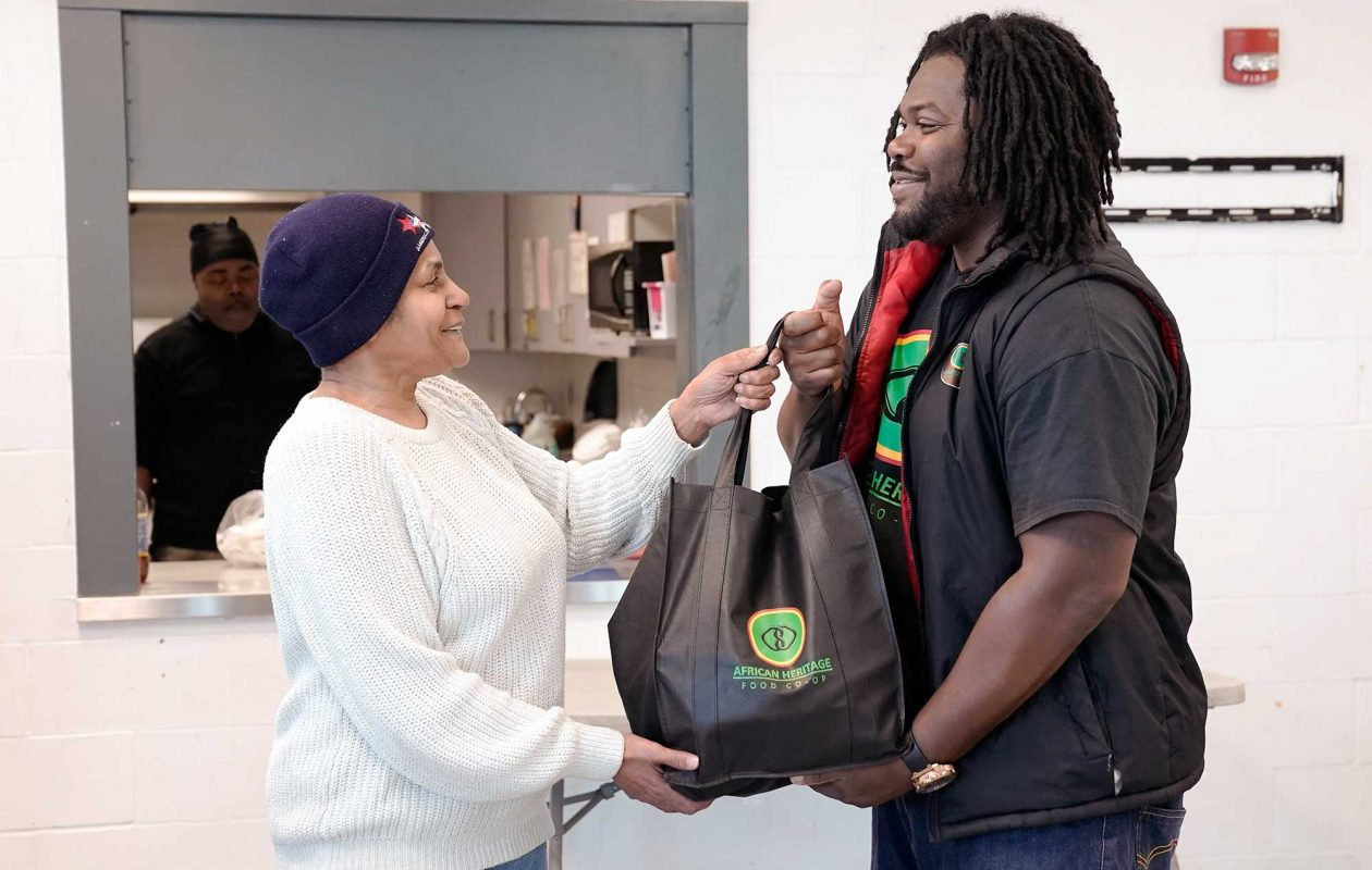 Alexander Wright, right, founded the African Heritage Food Co-op to provide fresh fruits and veggies to neighborhoods with limited access. (Dave Jarosz)