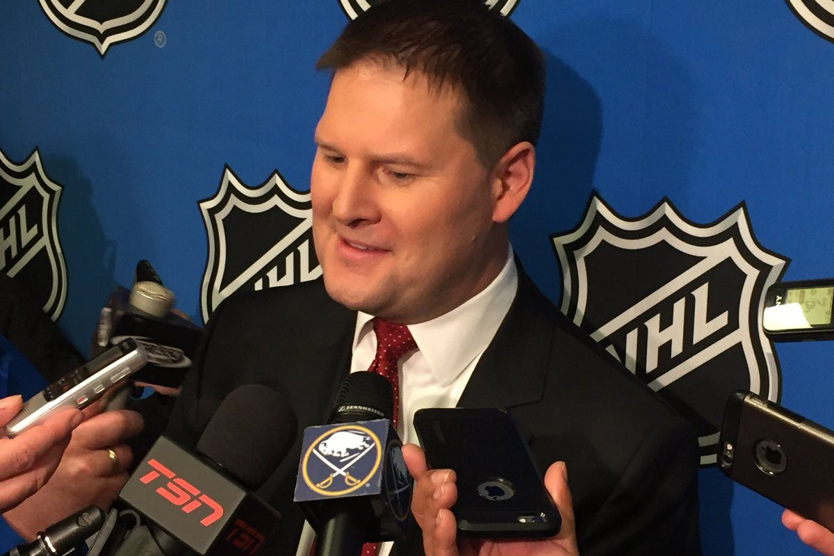 Jason Botterill is all smiles after Saturday night's lottery victory (Mike Harrington/Buffalo News).