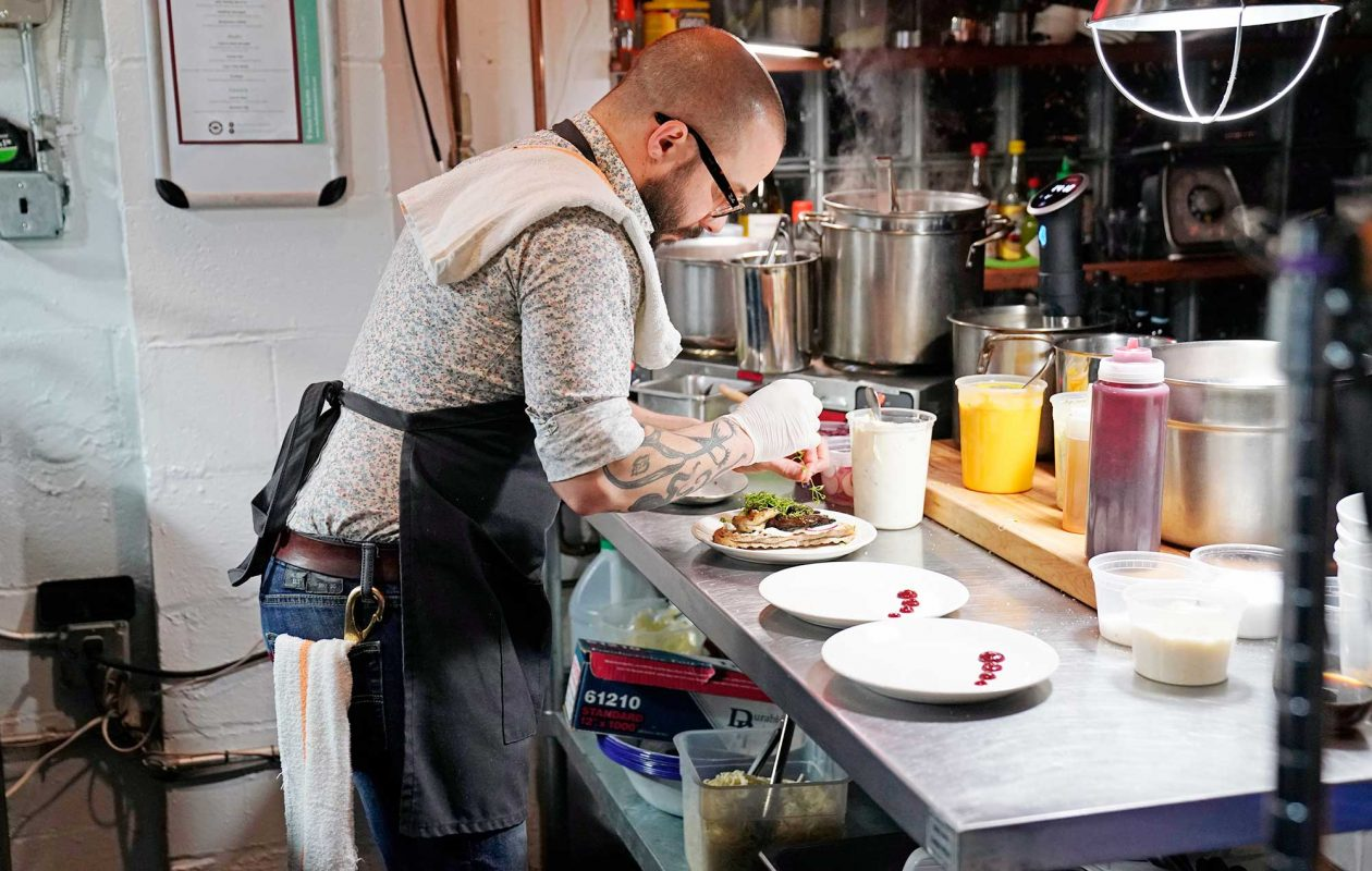 The chef at Black Iron Bystro prepares a meal for the Buffalo Dinner Club.