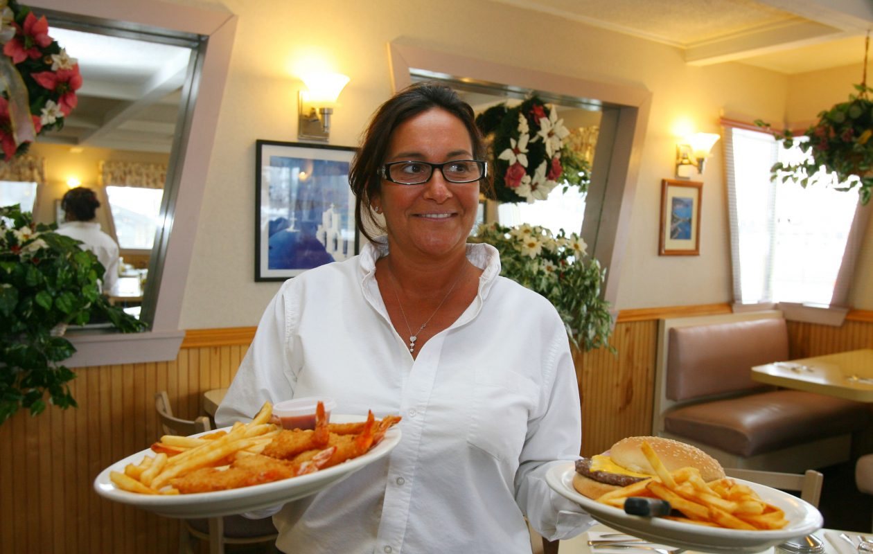 In this 2008 file photo, waitress Robyn Lapides brings two meals out to her customers at Christopher's Family Restaurant in Amherst. The restaurant late last week bought its longtime home on Maple Road. (Buffalo News file photo)