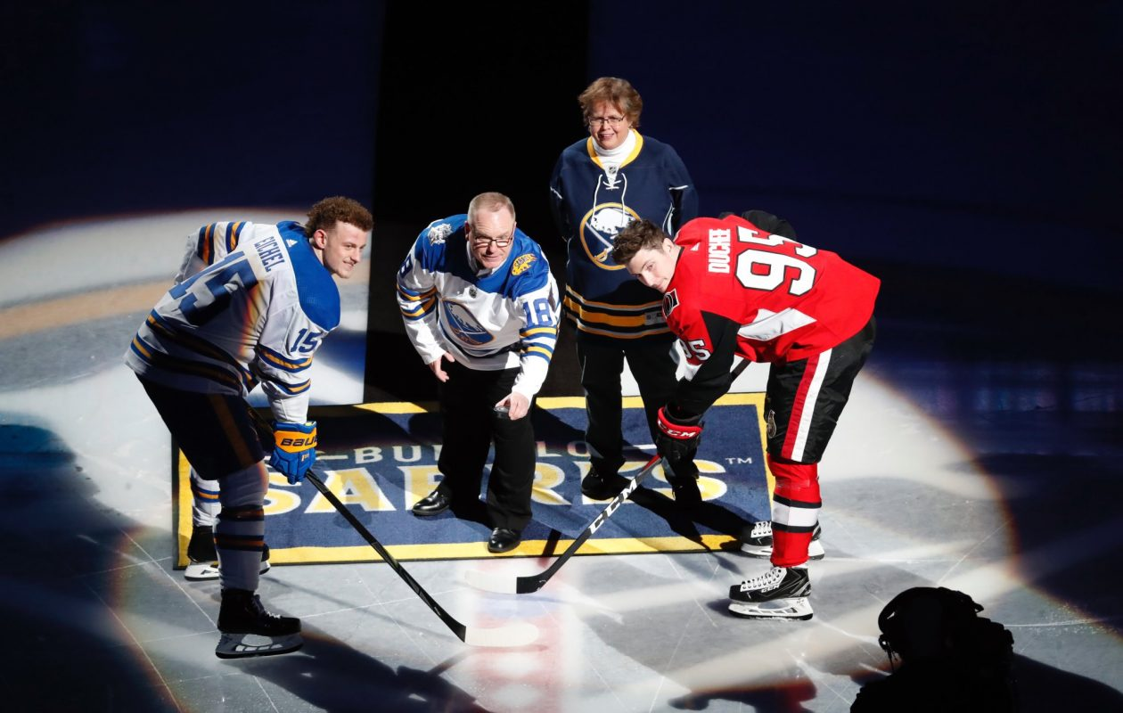 Michael Moskal, named the Sabres' Fan of the Year, drops the ceremonial faceoff Wednesday for Buffalo's Jack Eichel and Ottawa's Matt Duchene. (Harry Scull Jr./Buffalo News)