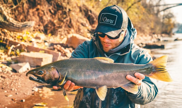 Drew Nisbet of Clarence shows off a Coho salmon he caught in the lower Niagara River last fall. Last year's run of Coho salmon was very good.