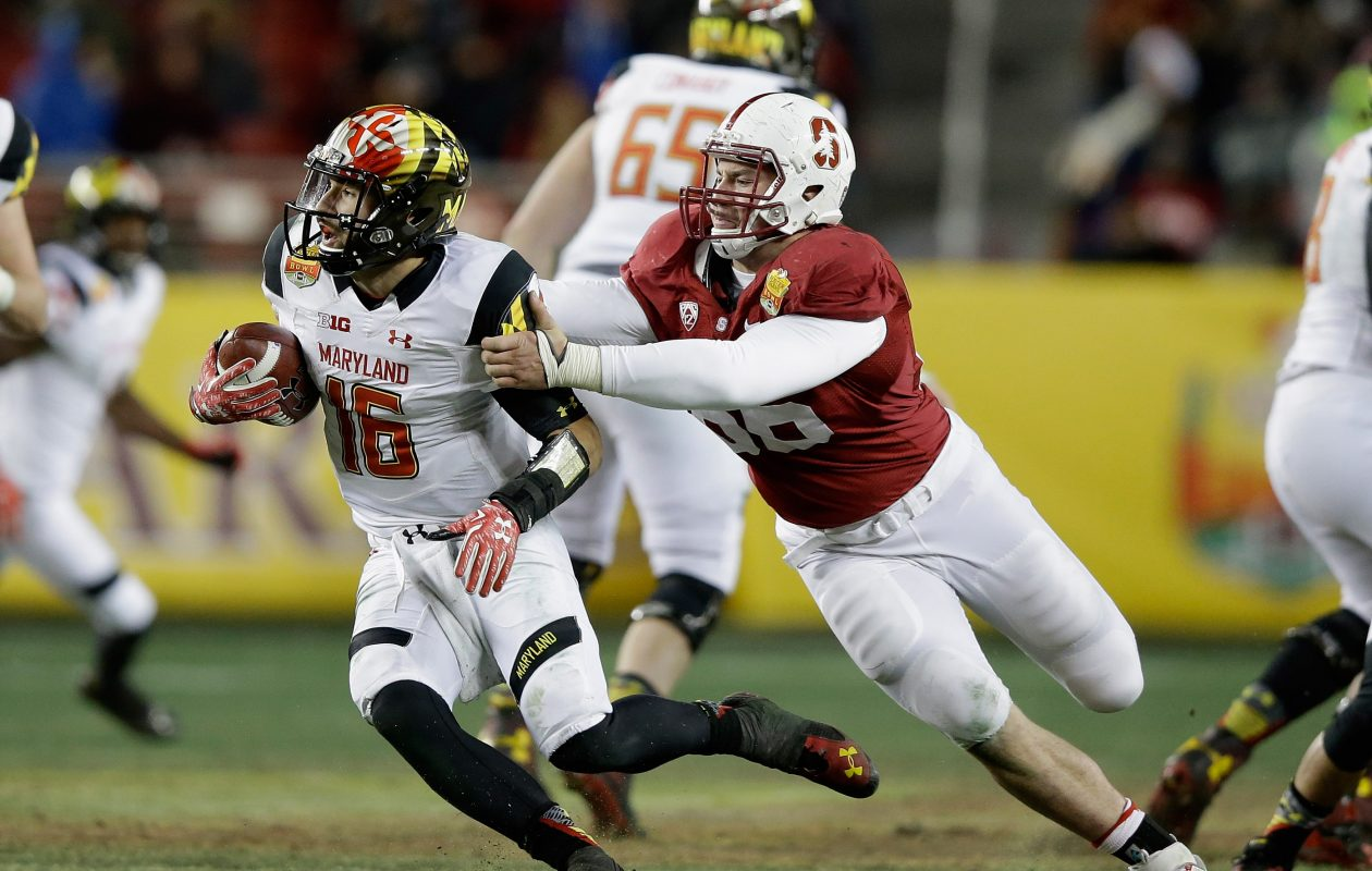 Harrison Phillips (66) of the Stanford Cardinal sacks C.J. Brown (16) of Maryland on December 30, 2014.  (Getty Images)