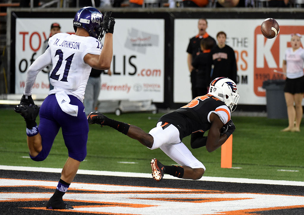 Wide receiver Victor Bolden #6 of the Oregon State Beavers can't hold onto a pass as cornerback Taron Johnson #21 of the Weber State Wildcats defends during the fourth quarter of the game at Reser Stadium on September 4, 2015 in Corvallis, Oregon.  (Photo by Steve Dykes/Getty Images)