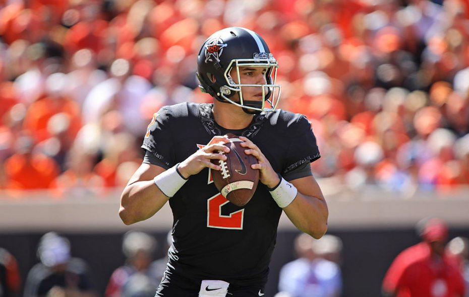 Mason Rudolph of Oklahoma State looks to throw against Texas on Oct. 1, 2016 at Boone Pickens Stadium in Stillwater, Oklahoma. (Photo by Brett Deering/Getty Images)
