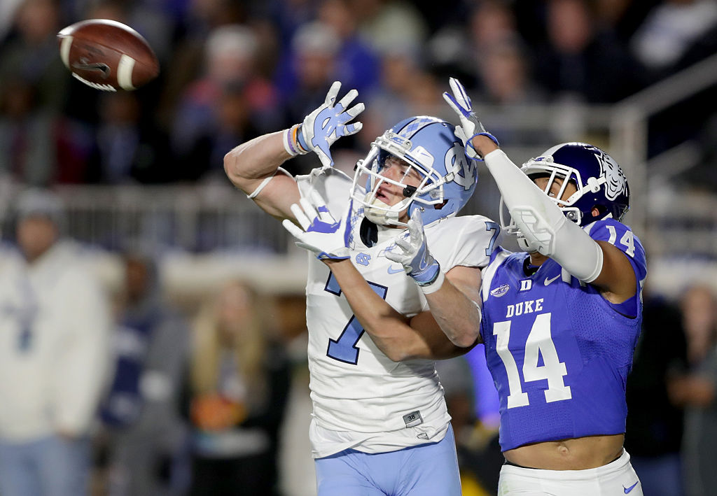 Bryon Fields #14 of the Duke Blue Devils breaks up a pass to Austin Proehl #7 of the North Carolina Tar Heels during their game at Wallace Wade Stadium on November 10, 2016 in Durham, North Carolina.  (Photo by Streeter Lecka/Getty Images)
