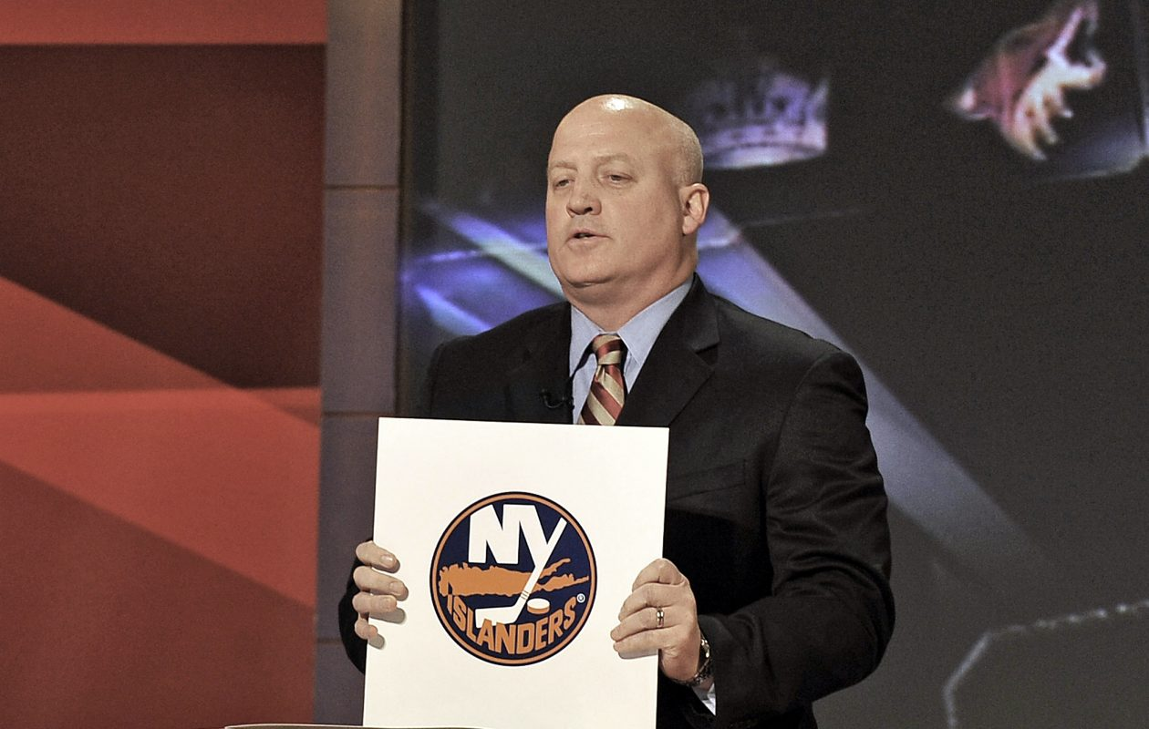 NHL Deputy Commissioner Bill Daly shows teams one-by-one during the Draft Lottery, starting with No. 15 and moving to No. 1. (Getty Images)