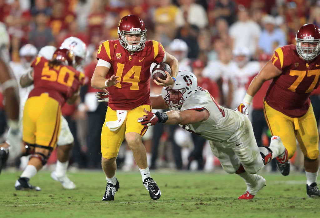 Harrison Phillips #66 of the Stanford Cardinal attempts to tackle Sam Darnold #14 of the USC Trojans during the fourth quarter at Los Angeles Memorial Coliseum on September 9, 2017 in Los Angeles, California.  (Photo by Sean M. Haffey/Getty Images)