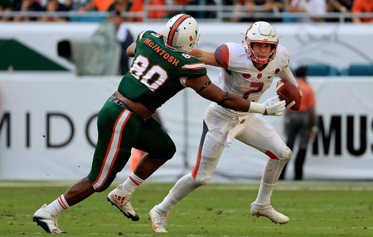 RJ McIntosh pursues Syracuse QB Eric Dingey (Mike Ehrmann/Getty Images)