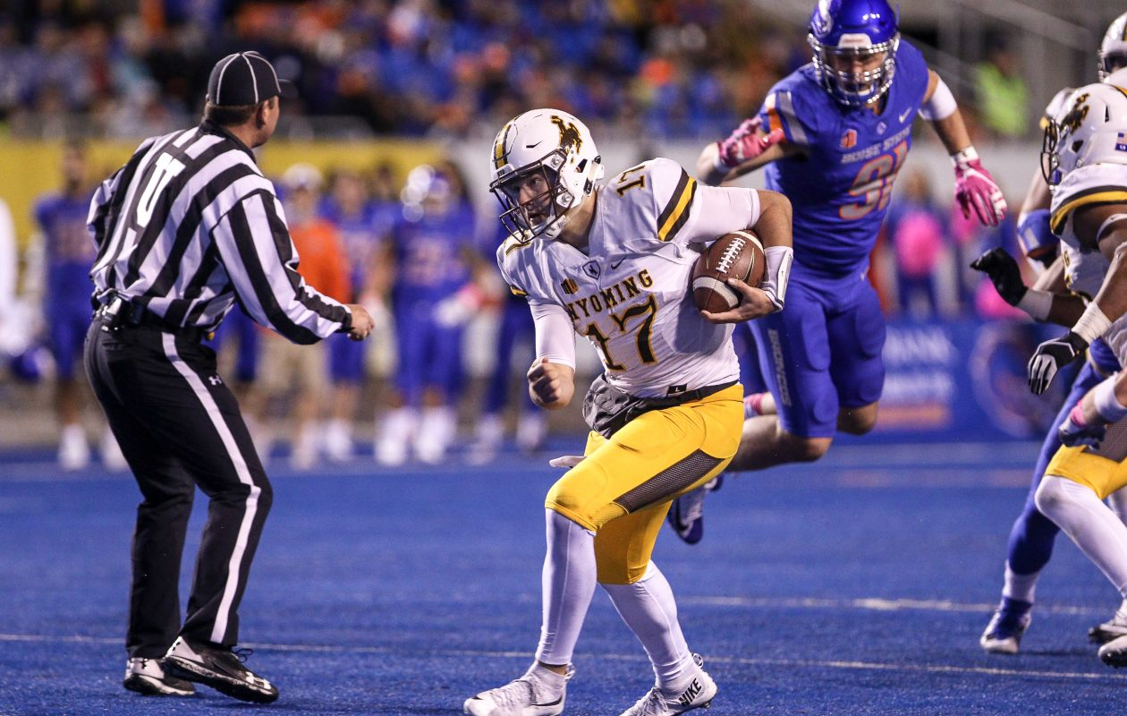 Quarterback Josh Allen of Wyoming Cowboys scrambles for extra yards against Boise State. (Loren Orr/Getty Images)