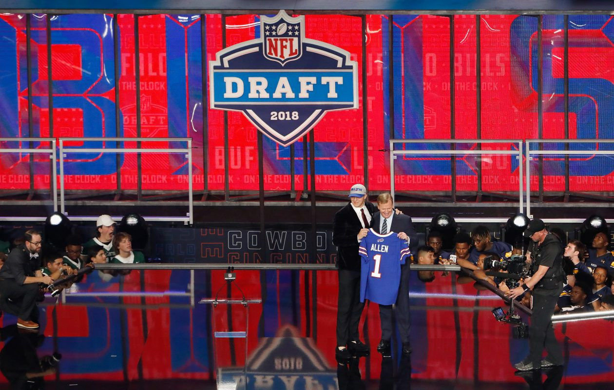 Josh Allen of Wyoming poses with NFL Commissioner Roger Goodell after being picked No. 7 overall by the Buffalo Bills. (Getty Images)