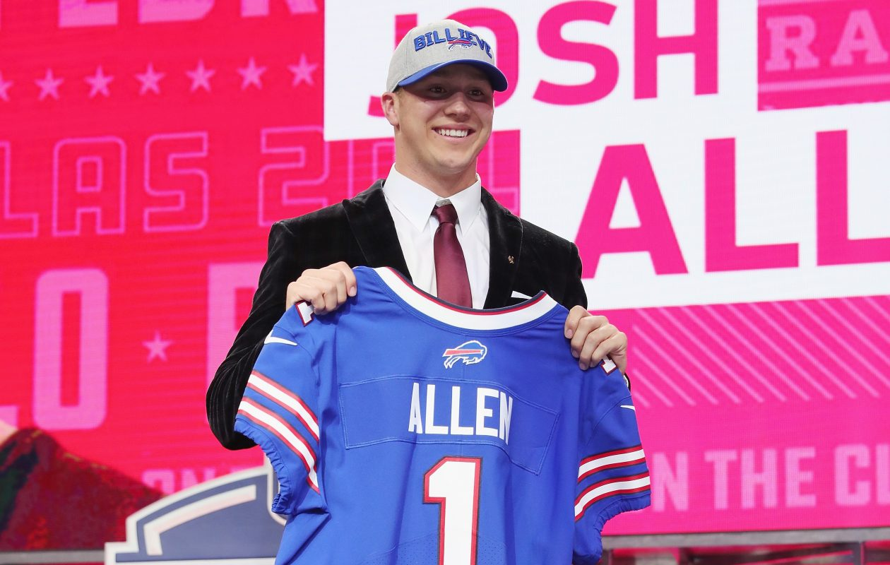 Josh Allen of Wyoming poses after being picked seventh overall by the Buffalo Bills during the first round of the 2018 NFL Draft at AT&T Stadium on April 26, 2018, in Arlington, Texas. (Tom Pennington/Getty Images)