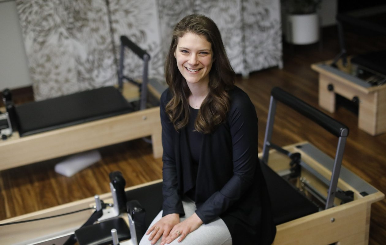 'There's a misconception that Pilates is all stretching and it's not,' says Hayley Sullivan, who started Long + Lean Pilates about five years ago. (Derek Gee/Buffalo News)