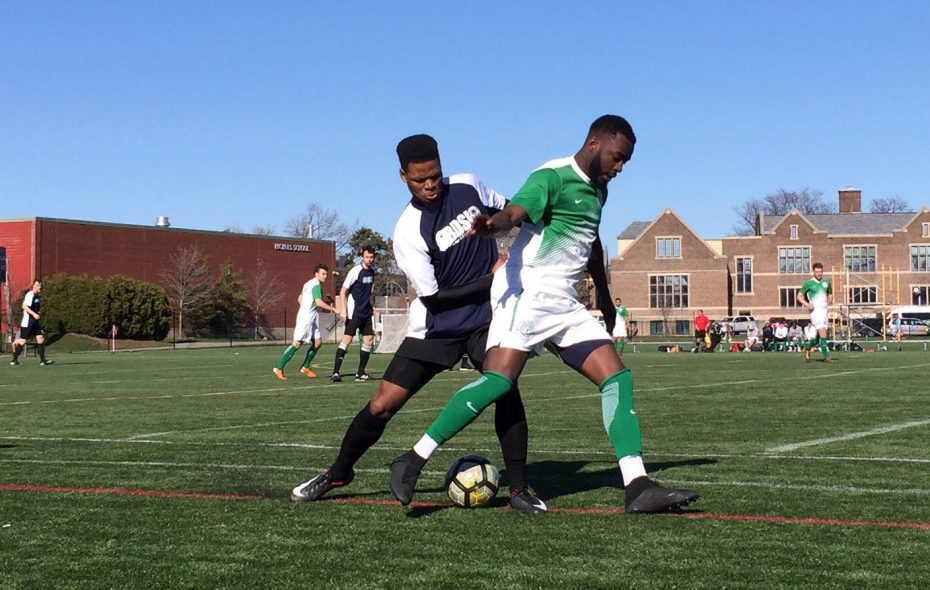Mohamed Musse, in blue, defends FC Motown's Mike Olla. (Ben Tsujimoto/Buffalo News)