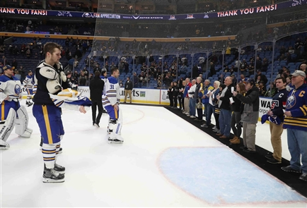 Buffalo Sabres players give game-worn jerseys to fans