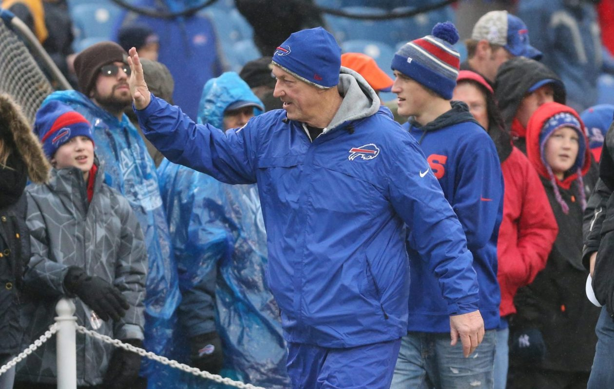 Jim Kelly waves to fans at a Buffalo Bills game. (James P. McCoy/News file photo)