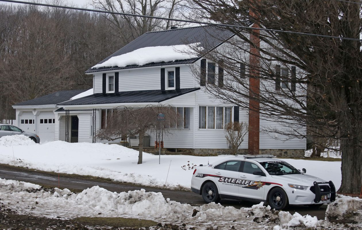 New York State police, Wyoming County deputies investigate the murder scene at the home of Joseph Mlyniec, on Route 246 in Perry.  Mlyniec is accused of shooting Robert Irvine III in this home's drieway.    This was on March 8, 2018.  (Robert Kirkham/Buffalo News)