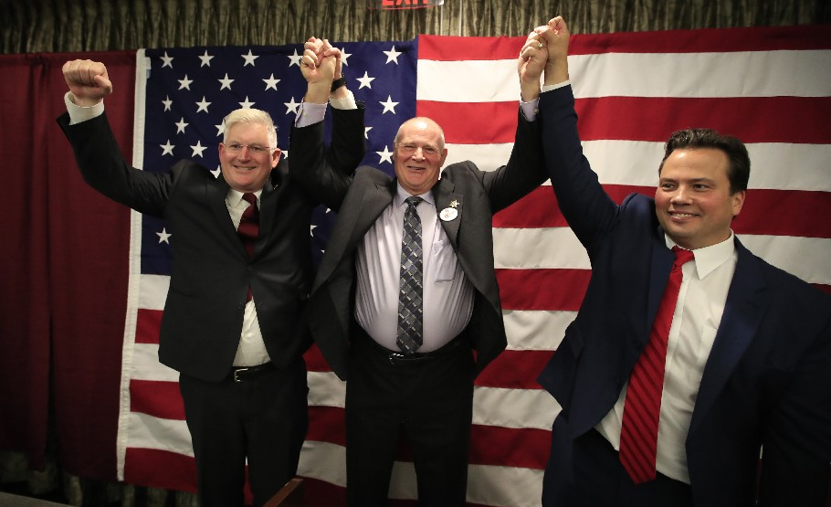 Erie County Clerk Michael P. Kearns, left, is following the bad example of Sheriff Timothy B. Howard, center, by pledging not to enforce a law that, if passed, would allow illegal immigrants to obtain drivers licenses. (Harry Scull Jr./Buffalo News)