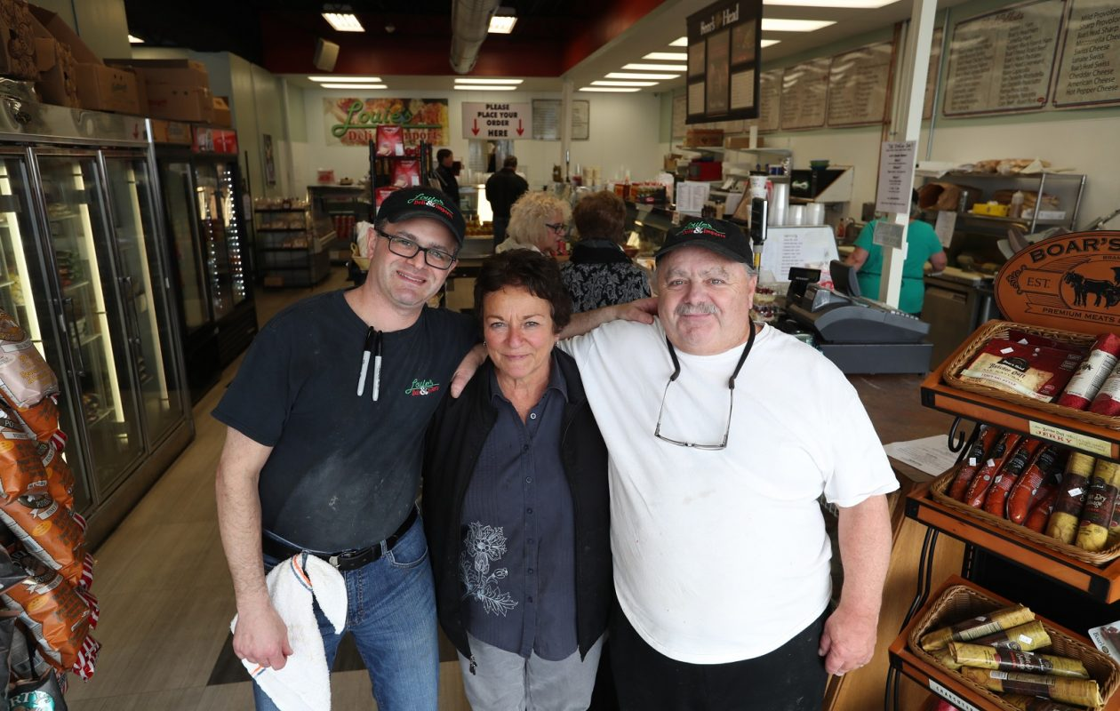 From left are Louie's Deli owners Louie Yannello Jr., and his parents Linda and Louie Yannello, who started the business. (Sharon Cantillon/Buffalo News)