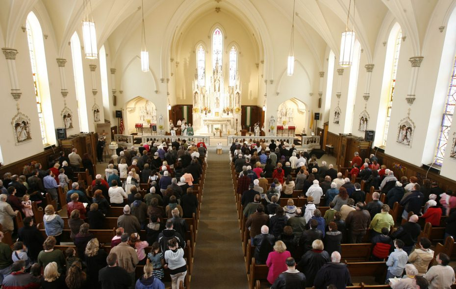 Parishioners pack a Mass at All Saints Church in Lockport in this Feb. 3, 2008 file photo.  The Catholic Diocese of Buffalo Bishop Richard J. Malone says donations to Catholic Charities annual fundraising drive are not being used to compensate clergy sexual abuse victims. But donations from parishioners throughout the diocese are used to pay insurance premiums and settle insurance claims. (File photo/Harry Scull Jr./The Buffalo News)