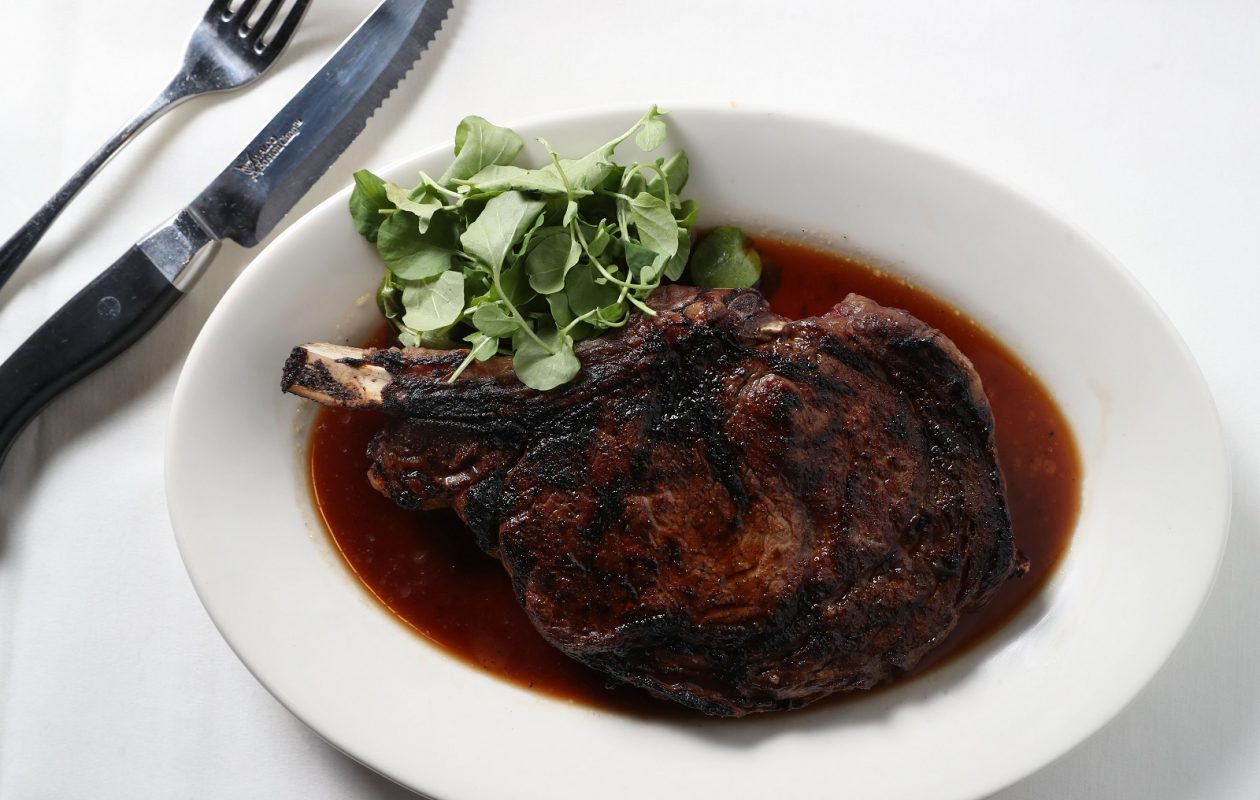 Morton's The Steakhouse's 22-ounce prime bone-in ribeye steak. (Sharon Cantillon/Buffalo News)