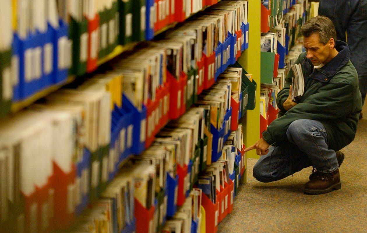 Dennis Laska, of North Tonawanda, searches the stacks at the North Tonawanda Public Library at 505 Meadow Drive in this file photo. (File photo/The Buffalo News)
