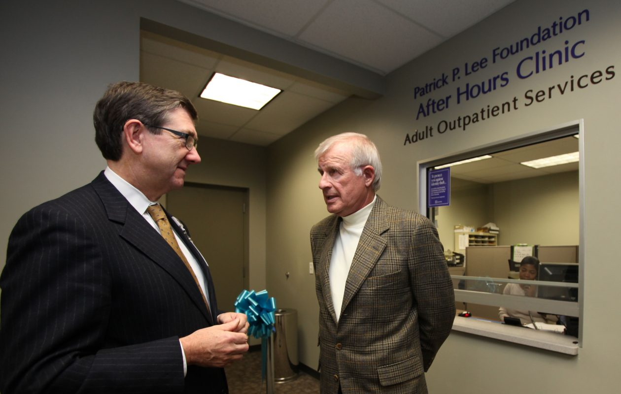 Jim Kaskie, then-president and CEO of Kaleida Health, left, talks with Patrick Lee following a ribbon-cutting ceremony for the new Patrick P. Lee Foundation After Hours Clinic, 1010 Main St. in Buffalo, on Dec. 12, 2011.  (Buffalo News file photo)