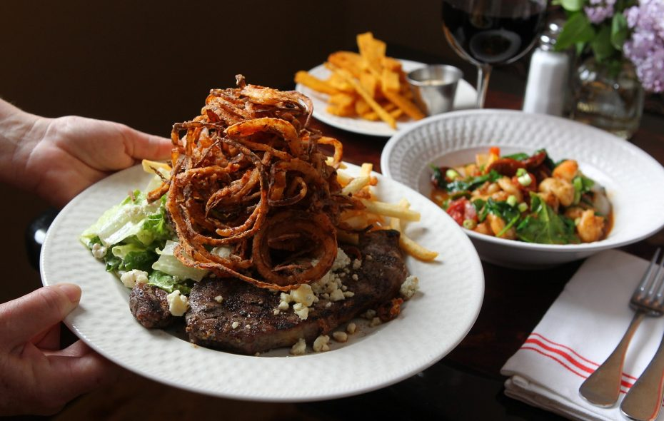 Steak frites, polenta fries, and shrimp and grits at The Phoenix, which will be taken over by former staffers. (Mark Mulville/Buffalo News)