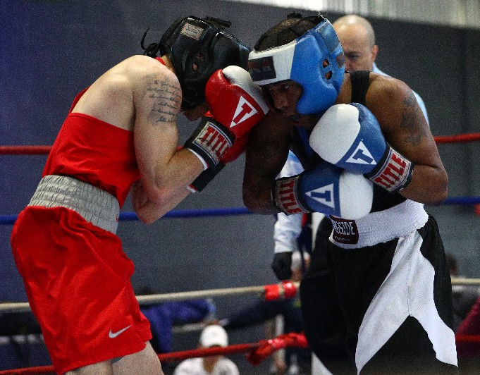 Joe Reed of Victory Boxing , boxes Elon Dejesus of Impact Boxing in the 123 Open of the New York State Golden Gloves finals on Sunday. Reed won the match. (John Hickey/Buffalo News)
