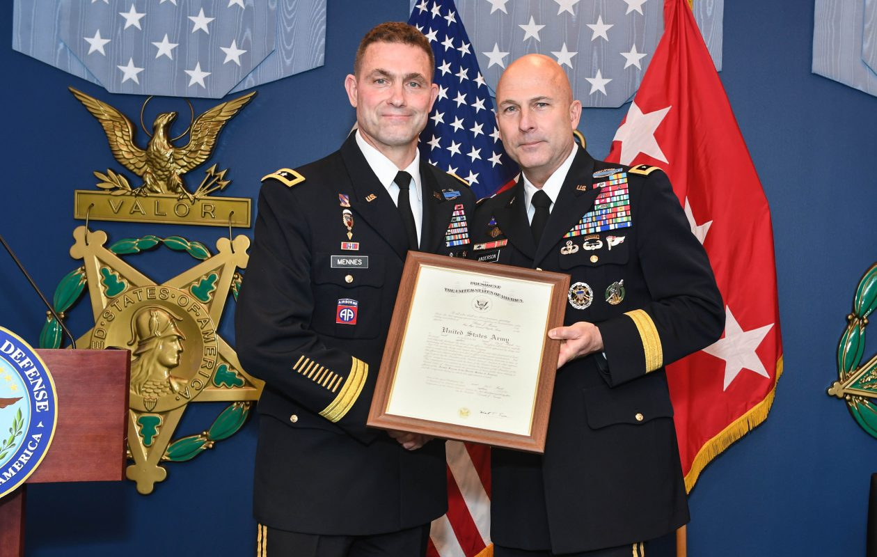Lt. Gen. Brian Mennes  accepts his promotion order to major general from Lt. Gen. Joseph Anderson in a ceremony at the Pentagon's Hall of Heroes. (Army photo by Spc. Tammy Nooner)