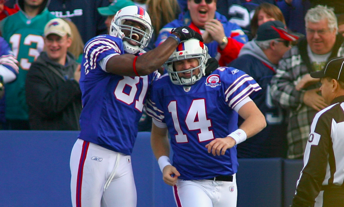 Terrell Owens #81 and Ryan Fitzpatrick #14 of the Buffalo Bills celebrate Fitzpatrick's 31 yard touchdown run against the Miami Dolphins at Ralph Wilson Stadium on November 29, 2009 in Orchard Park, New York. (Photo by Rick Stewart/Getty Images)