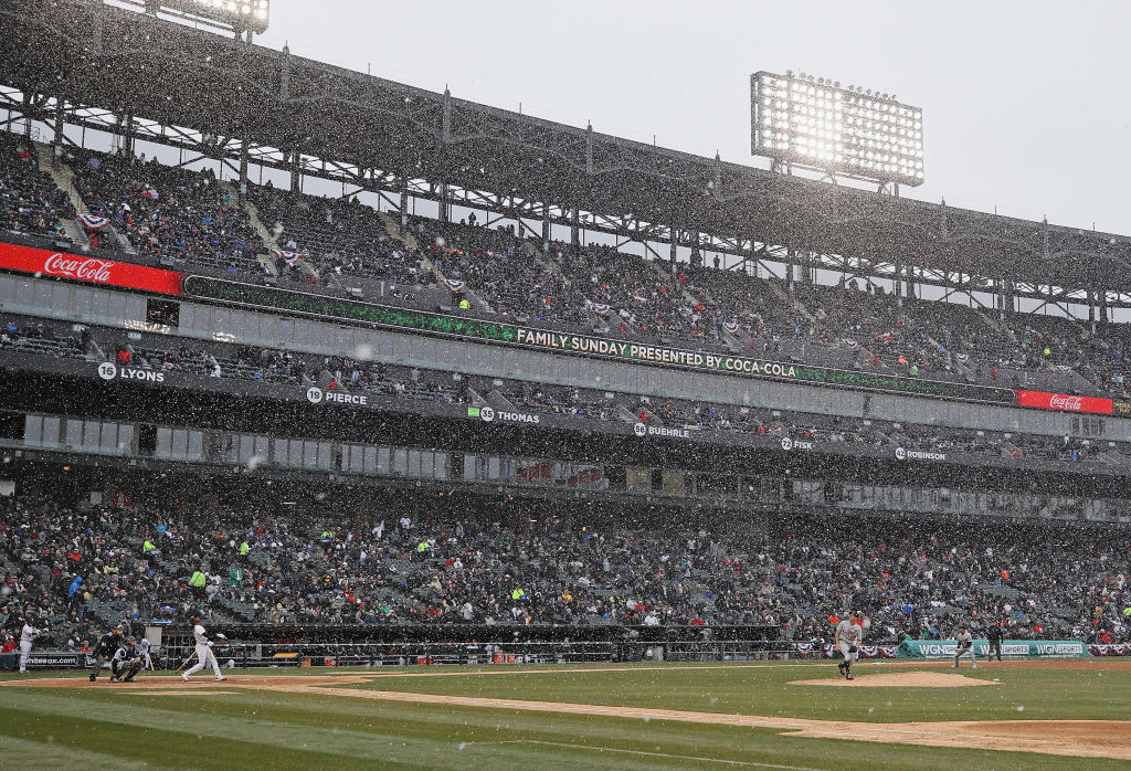 Snow buffets the players and fans in Chicago's Guaranteed Rate Field during the home opener for the White Sox against Detroit on April 5. (Getty Images)