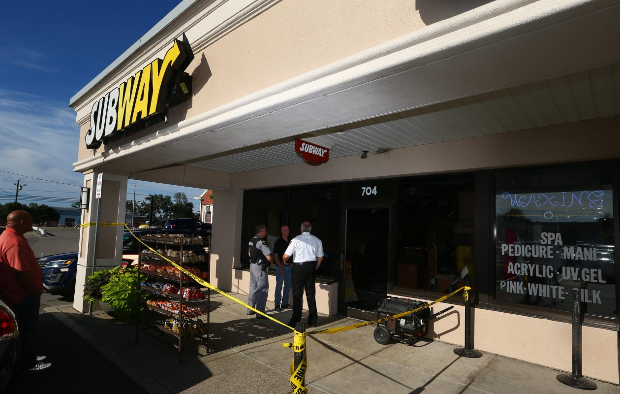Amherst Police and Fire investigators looked over scene and interviewed tenants after fire early Thursday caused an estimated $200,000 damage at several stores and restaurants in the Maple Forest Plaza, on July 30, 2015. The fire started at a Subway restaurant, which now will reopen as a Flip Burger. (John Hickey/Buffalo News)