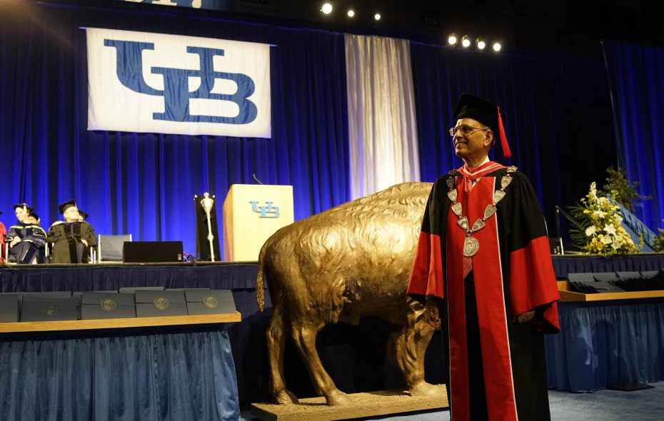 President Satish Tripathi greets graduates as they walk across the floor during the University at Buffalo commencement in Alumni Arena in 2017.  (Derek Gee/News file photo)