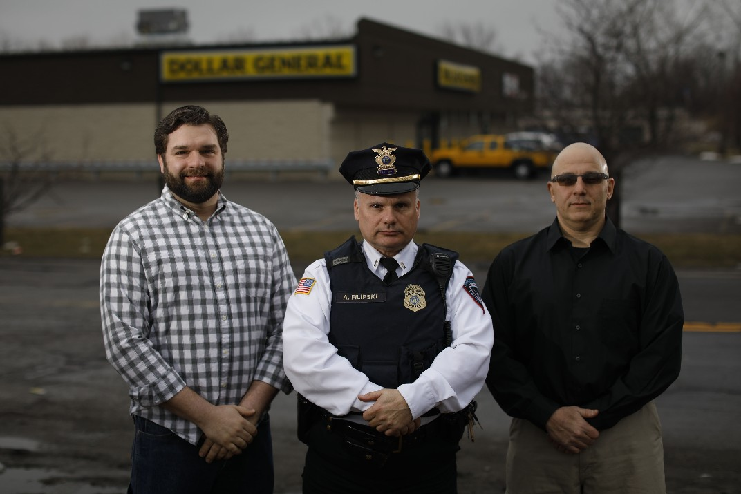 From left, Christopher Kaufmann, Cheektowaga Police Lt. Anthony Filipski and Mark Pinnavaia outside Dollar General on Union Road where they subdued a heavily armed gunman who was shooting at the store last November, Wednesday, March 28, 2018. (Derek Gee/Buffalo News)