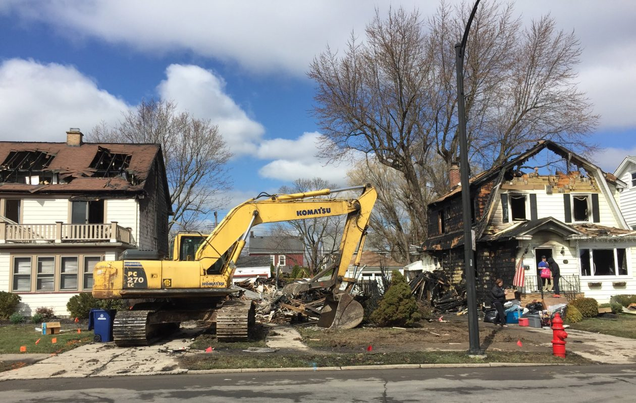 The scene on Covington Road in North Buffalo in April where Santo Cok allegedly caused an explosion that destroyed his house and severely damaged homes on either side. (Maki Becker/Buffalo News)