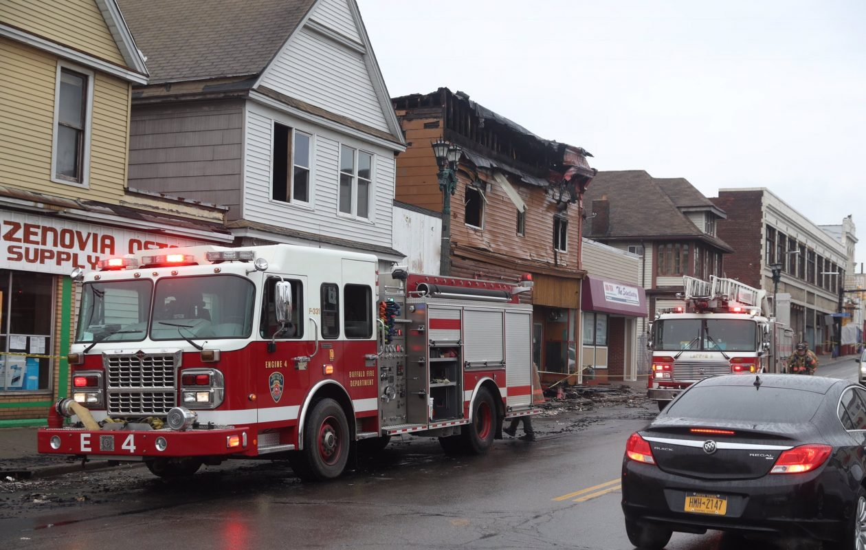 The Buffalo Fire Department returned to the scene of the overnight fatal fire in the apartments over TJ Coffey's bar to deal with hot spots at 2160 Seneca Street. (John Hickey/Buffalo News)