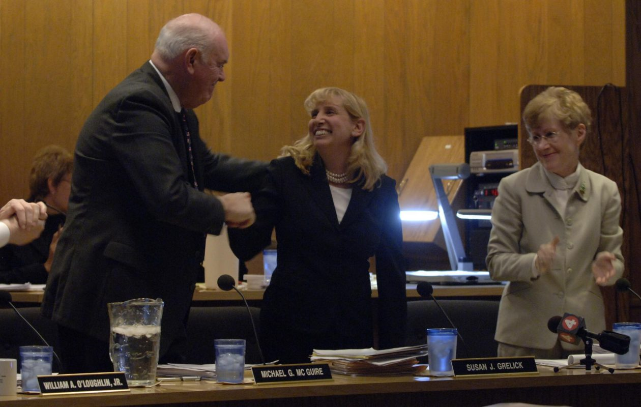 Susan Grelick, being congratulated at her final Amherst Town Board meeting, thinks her long tenure as supervisor plus her subsequent Albany experience position her well if she decides to run for an Assembly seat. (Harry Scull Jr./News file photo)