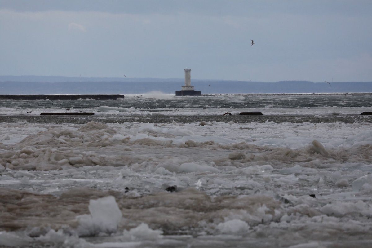 High winds pushed tons of lake ice over the ice boom and into Black Rock Channel where water levels nearing top of sea wall/over dock at BYC. (Derek Gee/Buffalo News)