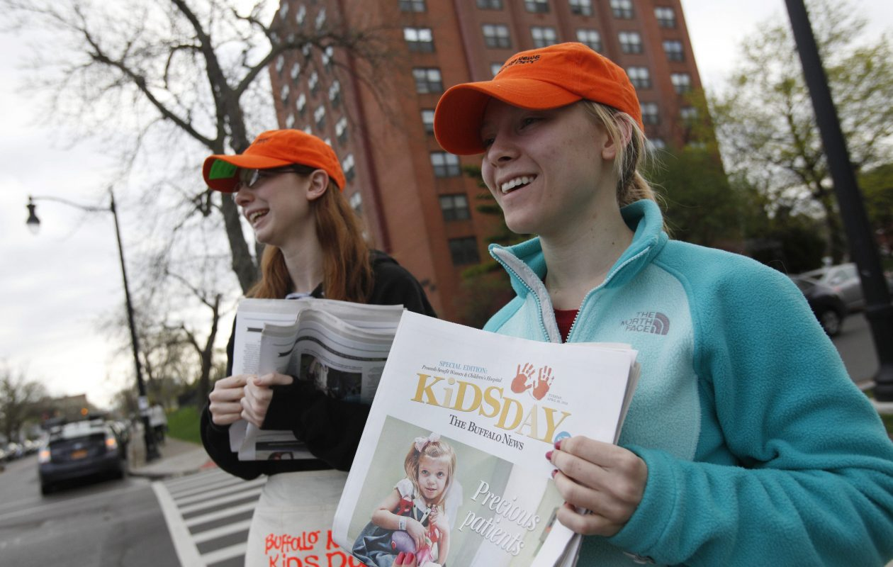 D'Youville College students Jessica Buttaggi, left, and Kaitlyn Reinhardt sell copies of the Kids Day edition of The Buffalo News on April 30, 2013.  (Derek Gee/Buffalo News)