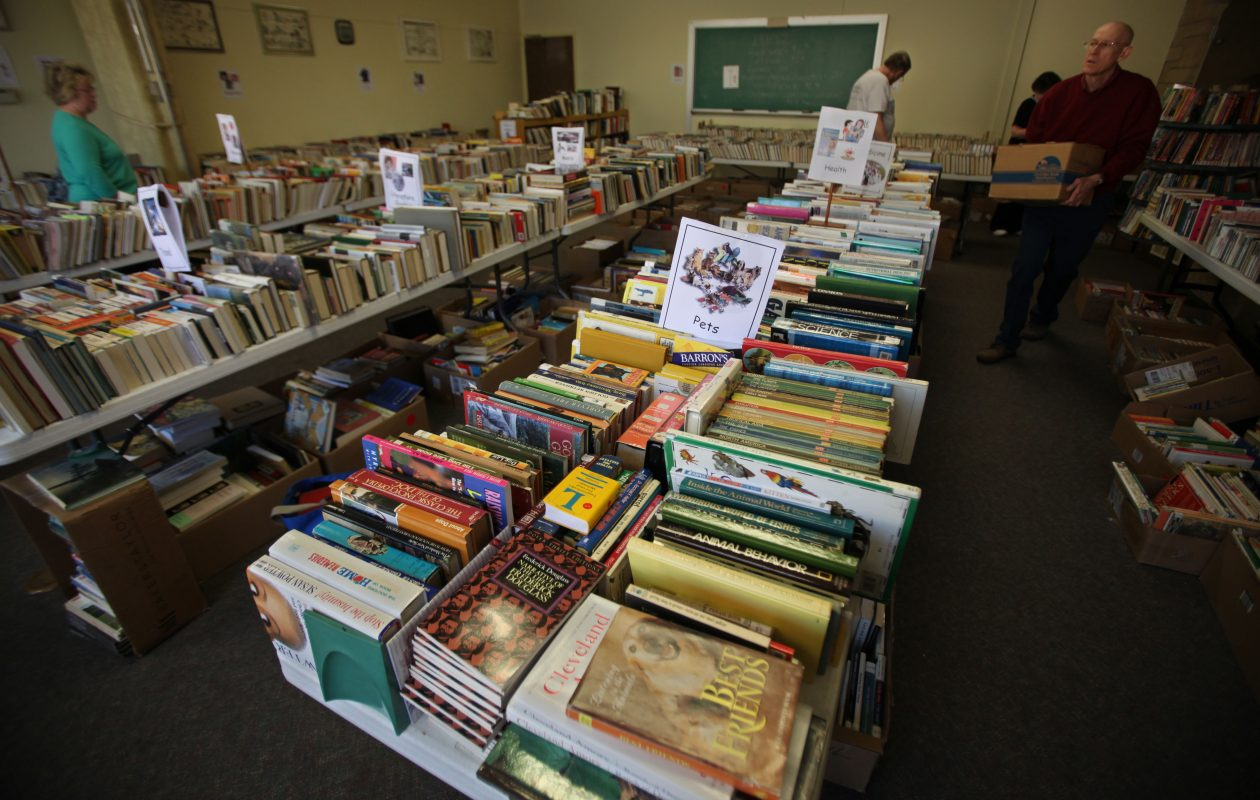 Patrons browse the annual book sale at North Tonawanda Public Library. (News file photo)