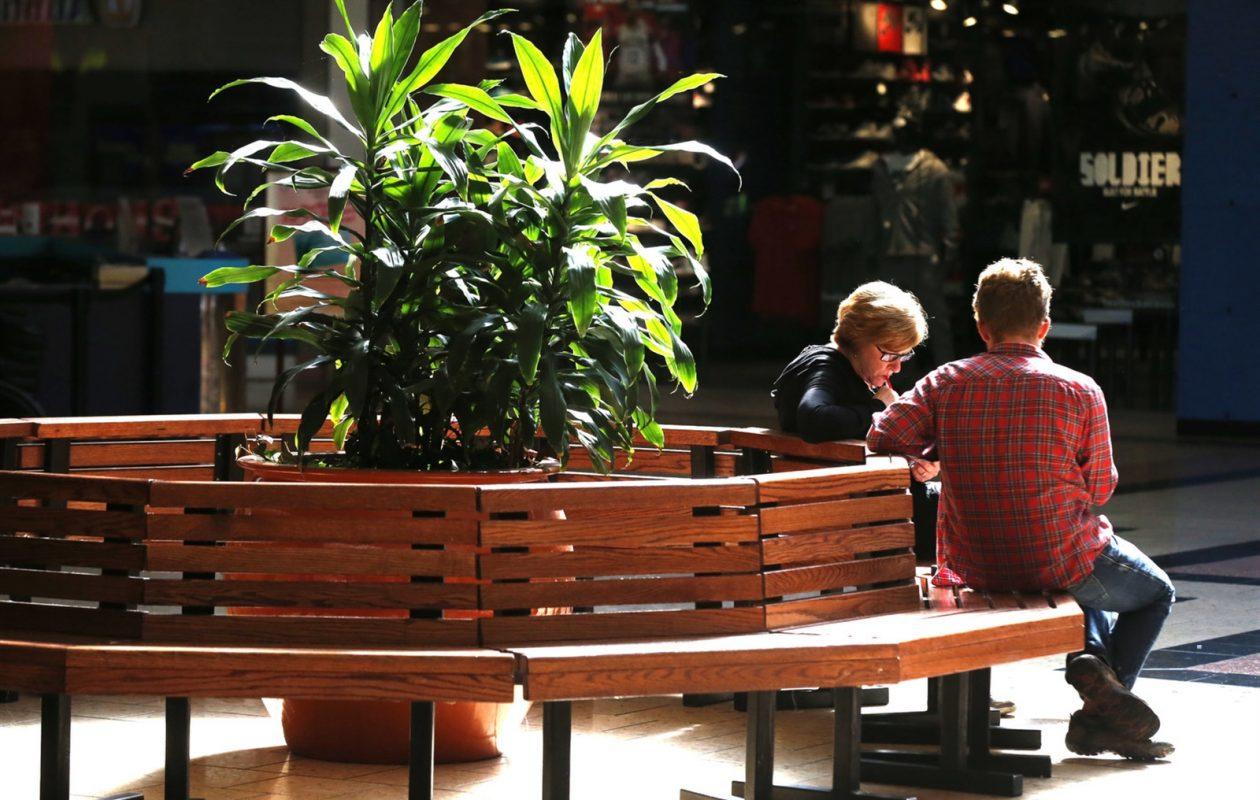 Shoppers sit at the McKinley Mall. (Robert Kirkham/Buffalo News)