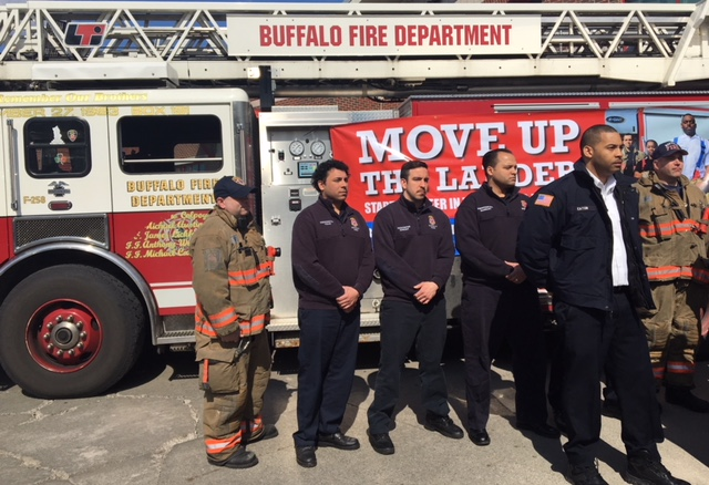 Buffalo Fire Department Deputy Commissioner Johnathan T. Eaton (pictured in the white shirt) joined other firefighters to encourage residents to sign up for the Firefighter Entry Exam.