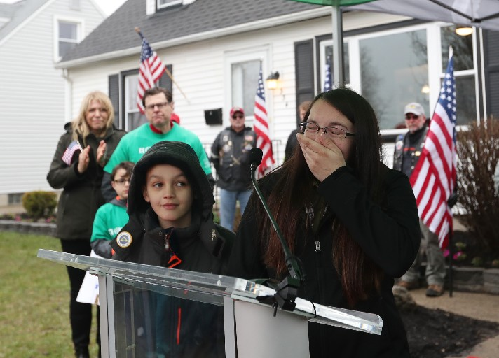 Christine Pusateri expresses gratitude for donated home as her son, Ryan, looks on. (Sharon Cantillon/Buffalo News)