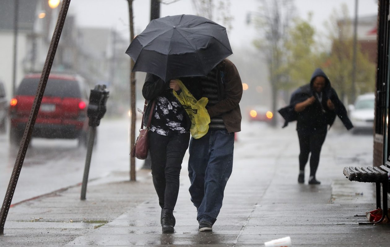 Pedestrians brave the wind and driving rain on West Ferry in Buffalo. (Mark Mulville/News file photo)