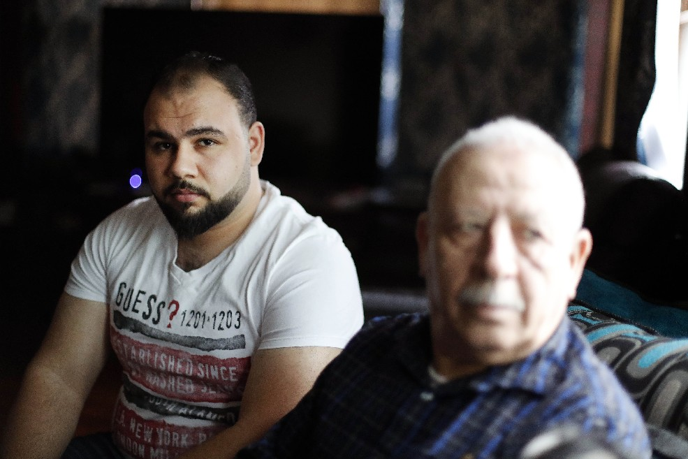Najati Ay Toghlo and his father, Mohammed Ay Toghlo, at their home in Buffalo. (Mark Mulville/Buffalo News