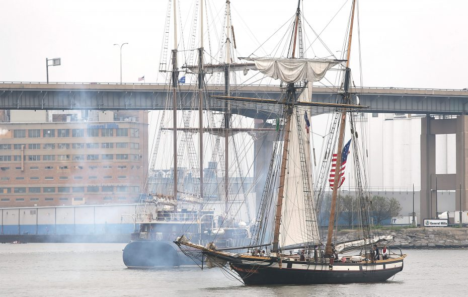 After firing one of it's canons, The Lynx from Portsmouth, N.H., right, and The Peacemaker prepare to dock at Canalside on Thursday, Sept. 12, 2013.  (Robert Kirkham/Buffalo News)
