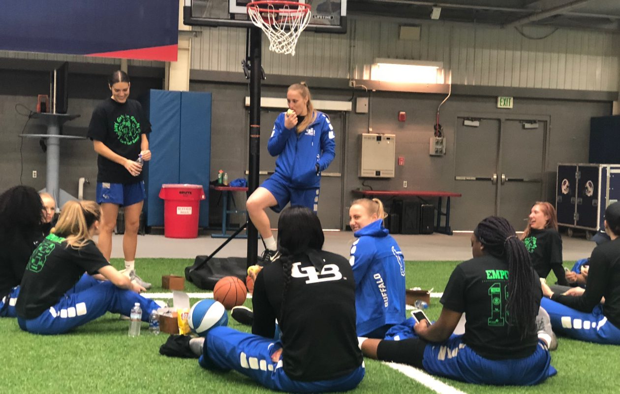 Liisa Ups and the UB women's basketball team prepare to share sports tips with girls ages 9 through 12. (Samantha Christmann/Buffalo News)