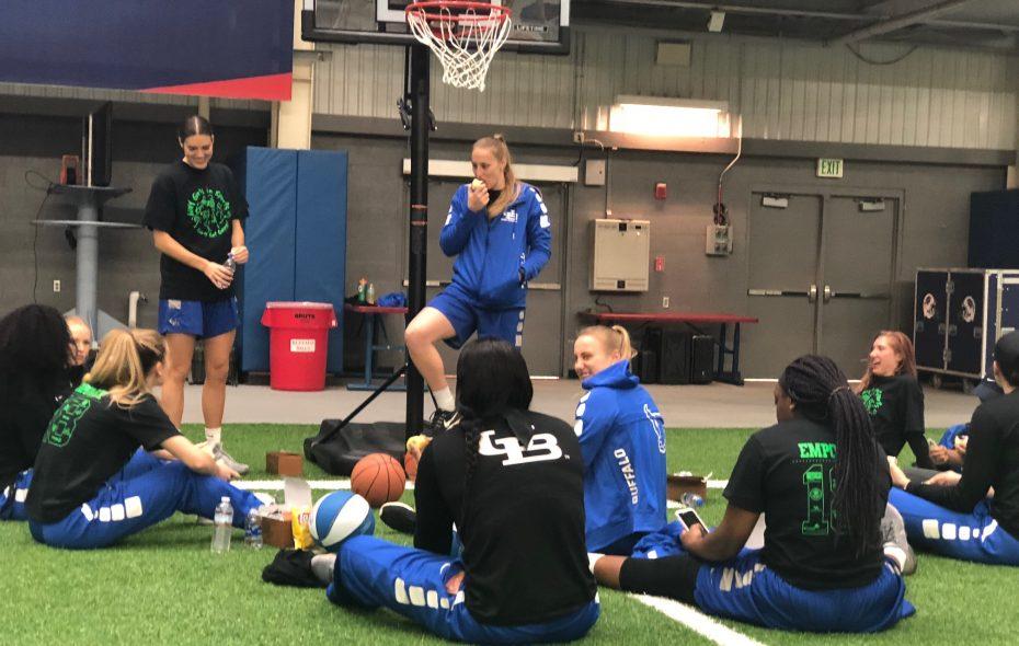 Liisa Ups and the UB women's basketball team prepare to share sports tips with girls ages 9 through 12. (Samantha Christmann/Buffalo News)